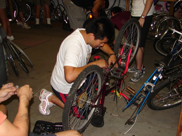 Nam works on a bike