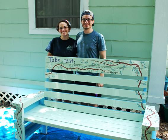 Gloria and Clayton after completing the parking lot oasis bench.